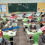 Chinese school kids return to classroom with the help of 'social distancing hats' (PHOTOS)